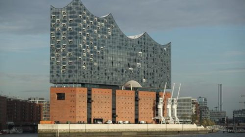 HAMBURG, GERMANY - NOVEMBER 04: The newly-completed Elbphilharmonie concert hall stands in the HafenCity district on the Elbe River on November 4, 2016 in Hamburg, Germany. Designed by the archiecture firm Herzog and de Meuron and begun in 2007, the Elbphilharmonie was originally slated to be completed by 2010 at a cost of EUR 241 million. Instead it was finally finished on October 31, 2016 at a cost of EUR 789 million. Germany has been burdened with a string of high-profile construction projects whose completion has been years delayed and whose costs have ballooned. The first public concert at the Elbphilharmonie is scheduled for January 11, 2017 as part of its official opening. (Photo by Sean Gallup/Getty Images)